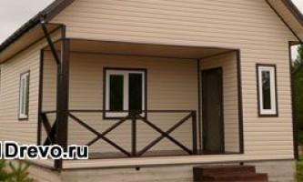 Отделка различным сайдингом фасада деревянного дома